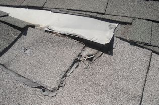 Denver Roof Maintenance and Repair - Bad Flashing and Exposed Nails