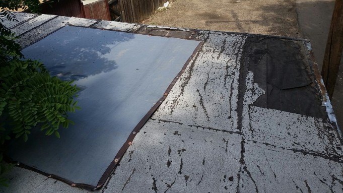 Tarp Roof or Roof Replacement